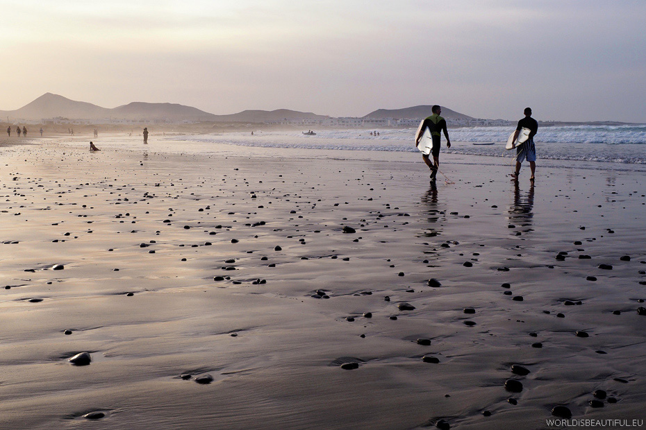 Surfers on the beach - Playa Famara